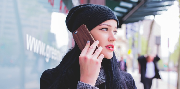 Woman Answers Robocall In Street